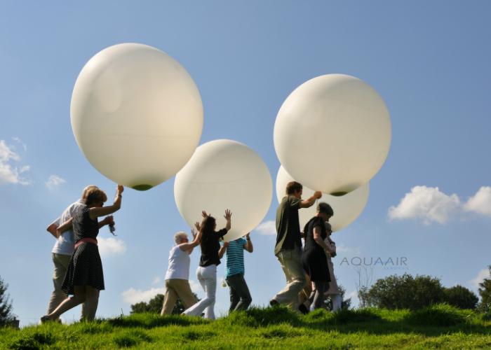 Ballonverstrooiing asverstrooiing per heliumballon van vader en moeder